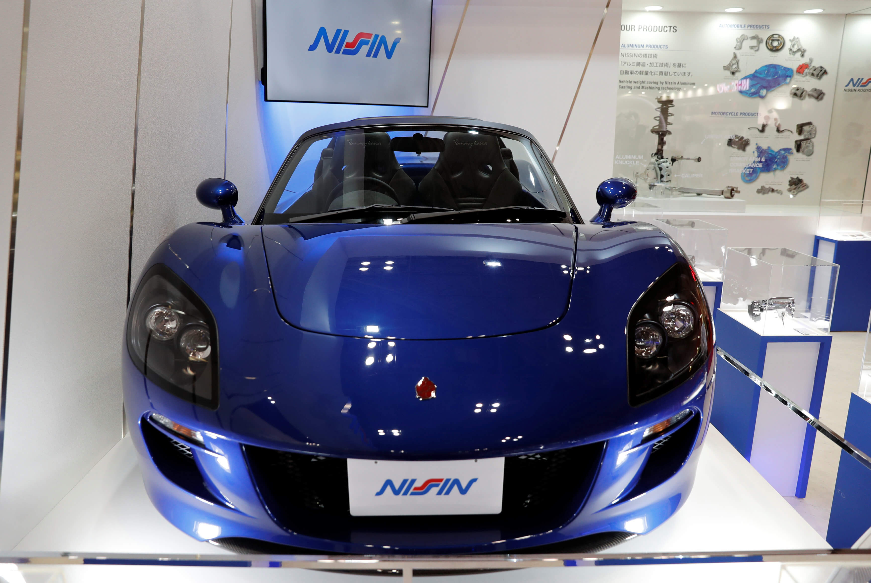 Green Lord Motors' sports EV Tommykaira ZZ is displayed at Japan's auto parts maker Nisshin Kogyo Co. booth during media preview of the 45th Tokyo Motor ...