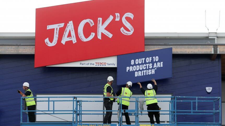 A logo is pictured above the entrance to a Jack's store during its press launch in Chatteris, near Cambridge, east of England, on September 19, 2018, during the lauch of the supermarket giant Tesco's latest discount venture. British supermarket giant Tesco on Wednesday announced plans for discount food stores across the country, as it comes under increasing pressure from German-owned Aldi and Lidl. Tesco, which is Britain's biggest retailer, said the first two Jack's stores open Thursday followed by up to another 13 over the next six months.
