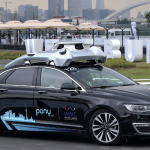 A driverless car by Pony.ai makes its way during the World Artificial Intelligence Conference 2018