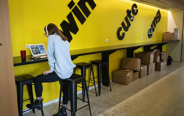 An employee works on a laptop at BuzzFeed headquarters, in New York City. . Source: Drew Angerer/Getty Images/AFP