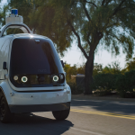 A Nuro autonomous car is seen driving down a road in Scottsdale, Arizona