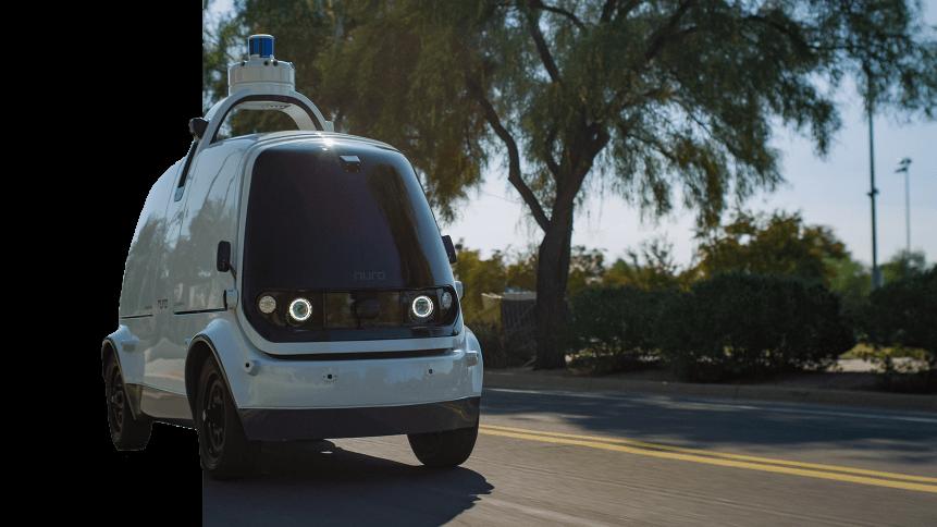 A Nuro autonomous car is seen driving down a road in Scottsdale, Arizona
