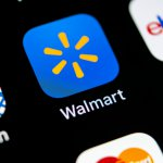 Walmart application icon on Apple iPhone X screen close-up. Walmart app icon. Walmart.com is multinational retailing corporation.