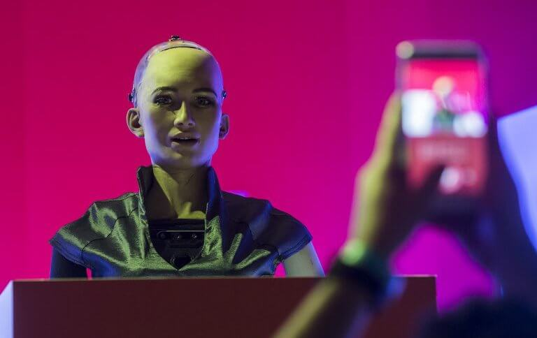 'Sophia the Robot' is seen on stage before a discussion by Hanson Robotics about Sophia's multiple intelligences and artificial intelligence (AI) at the RISE Technology Conference