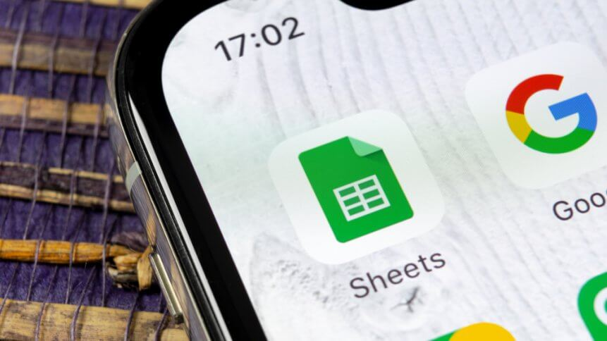 Google Sheets icon on Apple iPhone X smartphone screen close-up. Google sheets icon