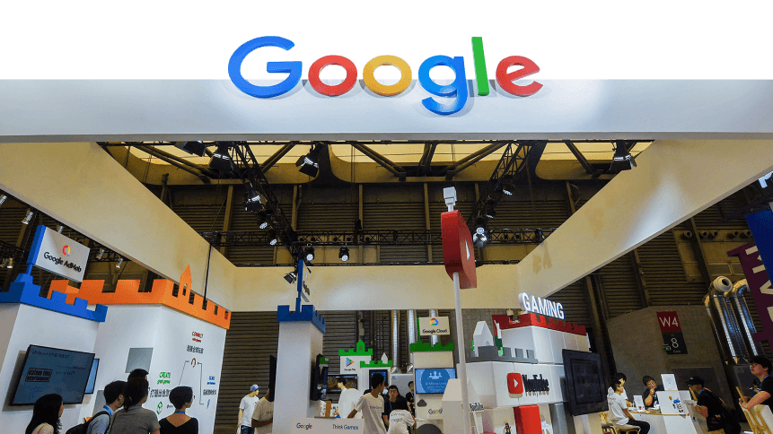 People gather at the booth of Google during the China Digital Entertainment Expo and Conference