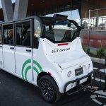 The Optimus Ride autonomous six-seater shuttle bus drives through the Brooklyn Navy Yard