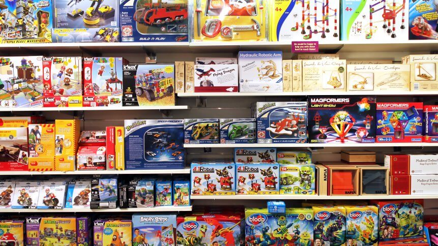 ariety of construction toys on shelves in a store. The Lego Group is the major manufacturer of construction toys in the world.