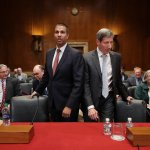 FCC Chairman Ajit Pai (L) and FTC Chairman Joseph Simons prepare to testify before the Senate Financial Services and General Government Subcommittee about their FY2020 budget. Senators asked about their plans for the future of 5G