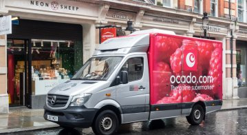 Online merchant Ocado making a delivery in the city of London.